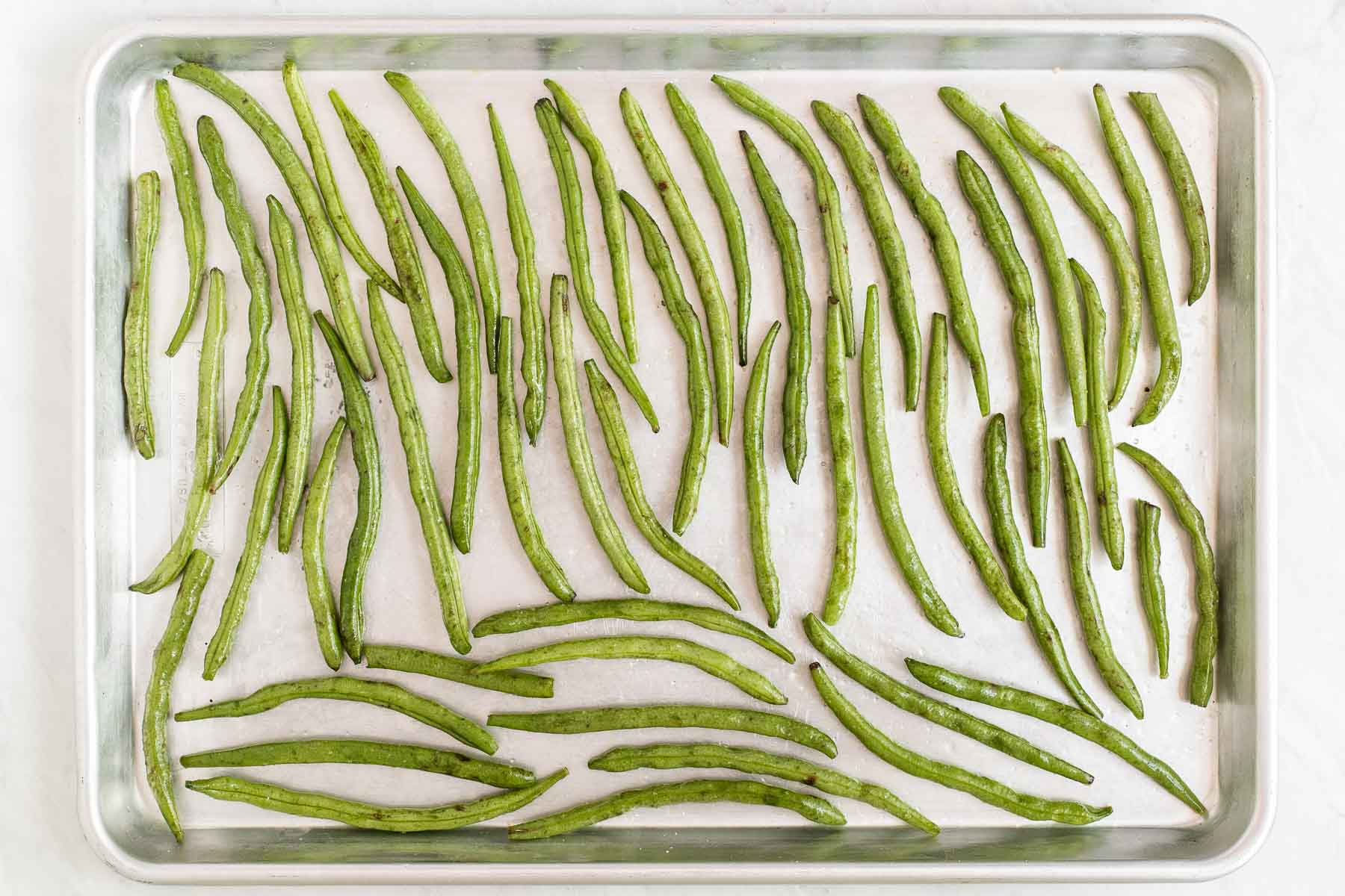 Green beans on a baking sheet.