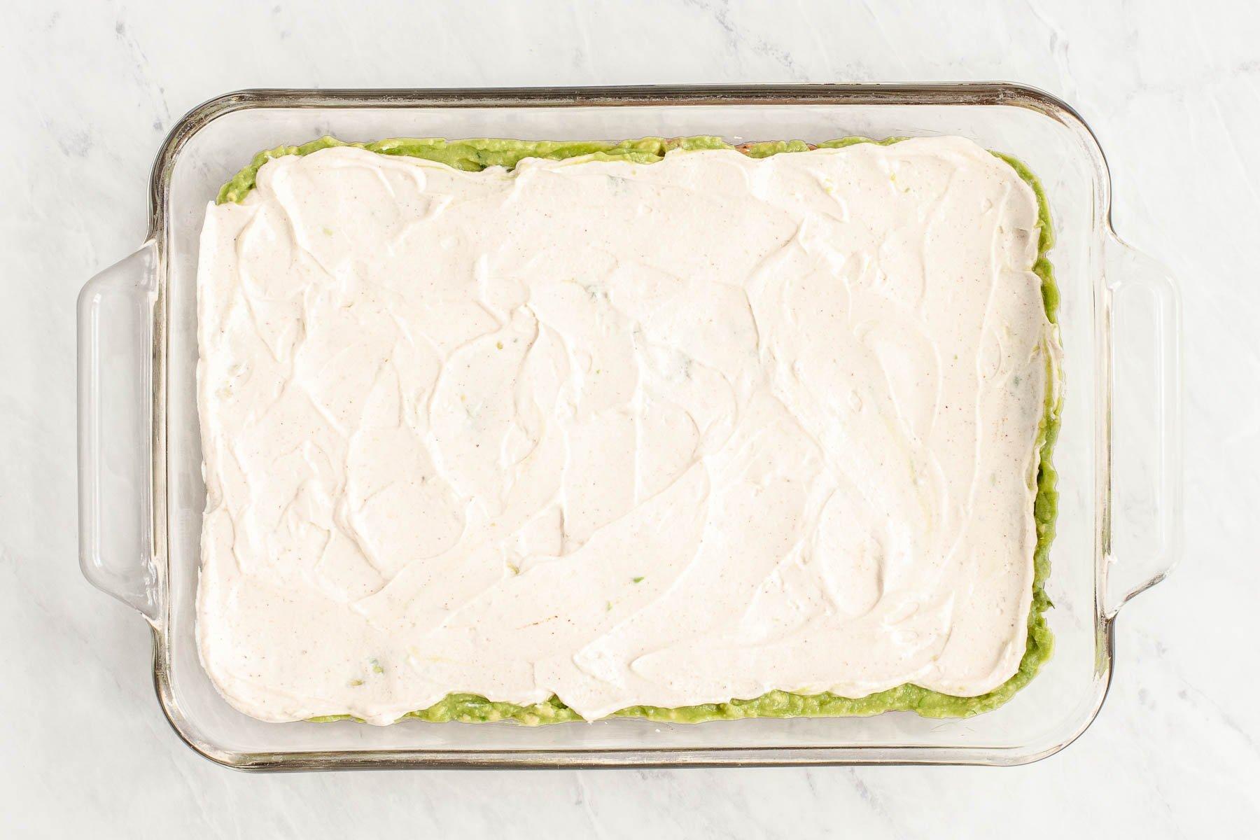 Sour cream spread in a clear glass dish.