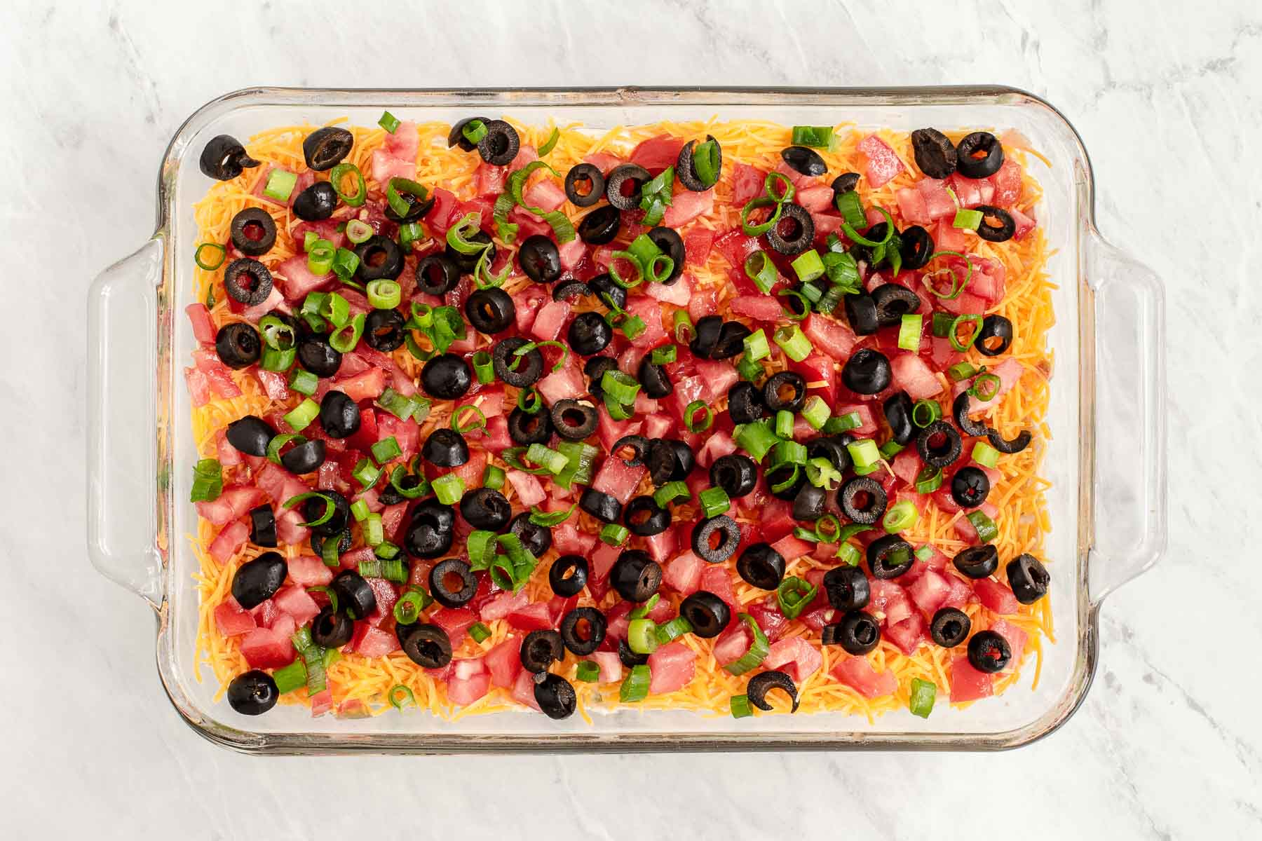 Seven layer dip in a 9 by 13 inch dish.