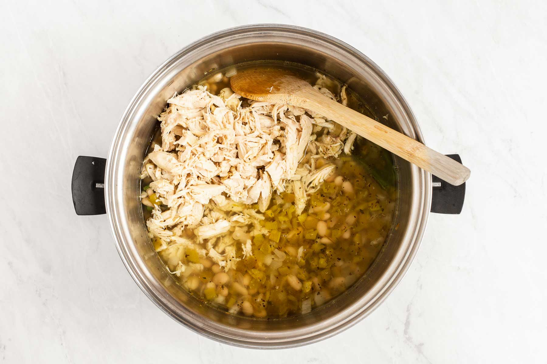 Soup pot with beans, chicken and green chiles.