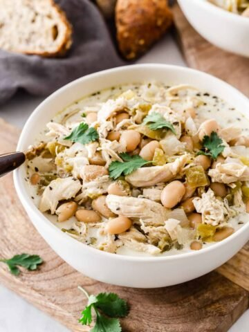 Bowl of white bean chicken chili with cilantro on top.