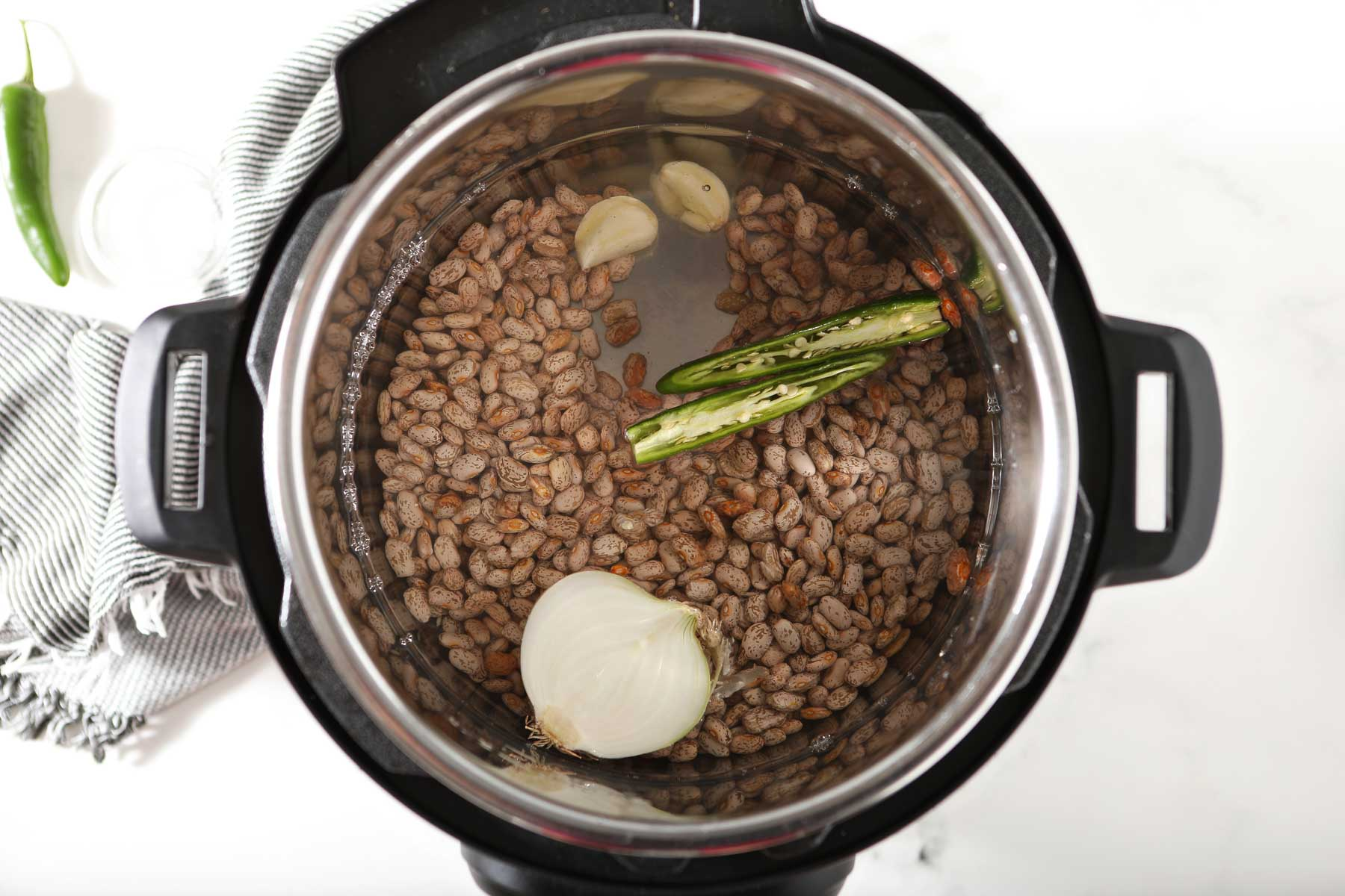 Instant pot with beans, water and spices.