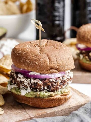 Black bean burger with toothpick on top.