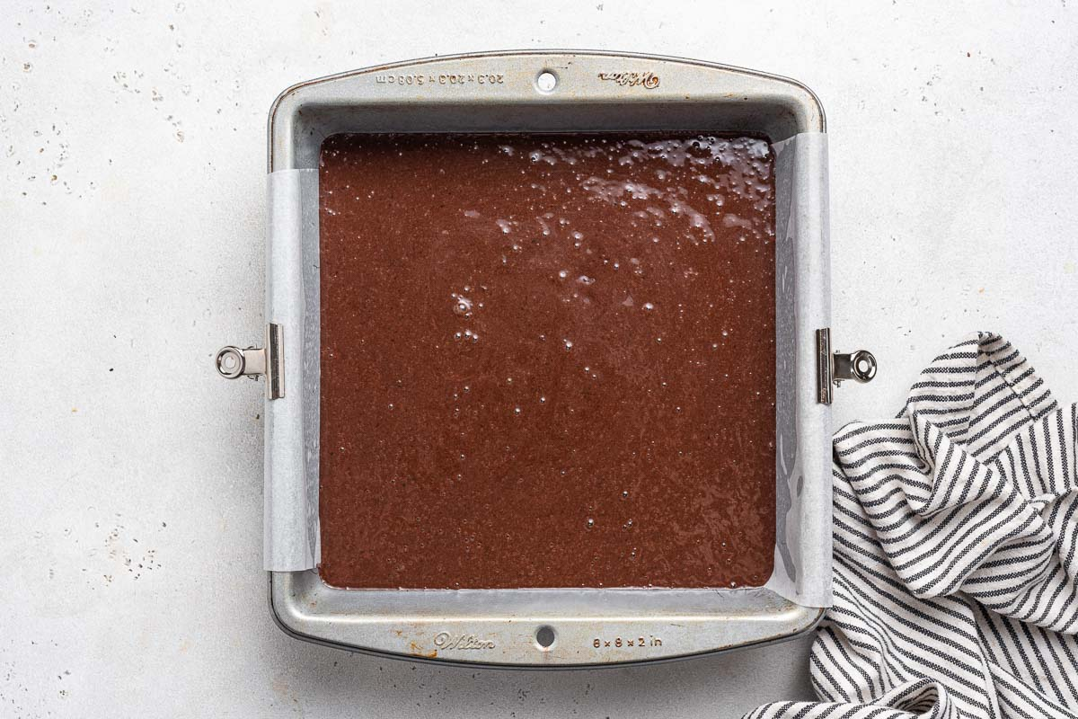 Raw black bean brownies in square pan before baking.