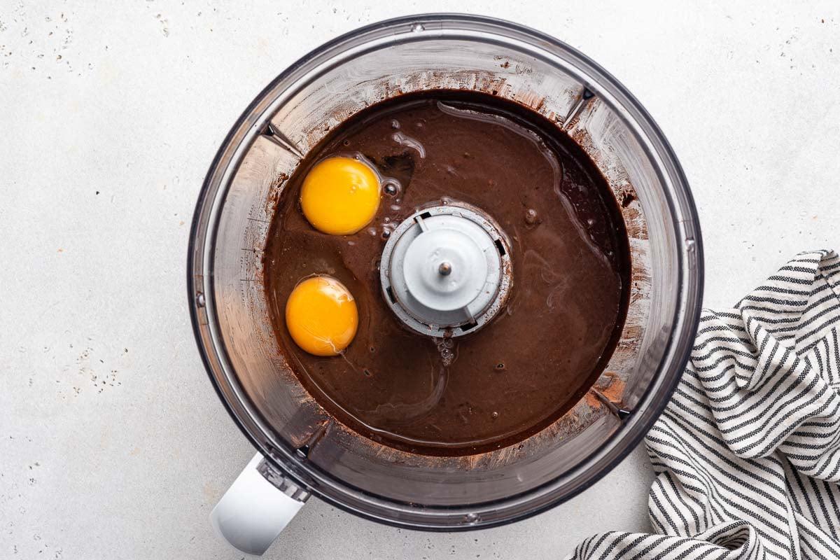 Eggs in food processor with black bean brownies.